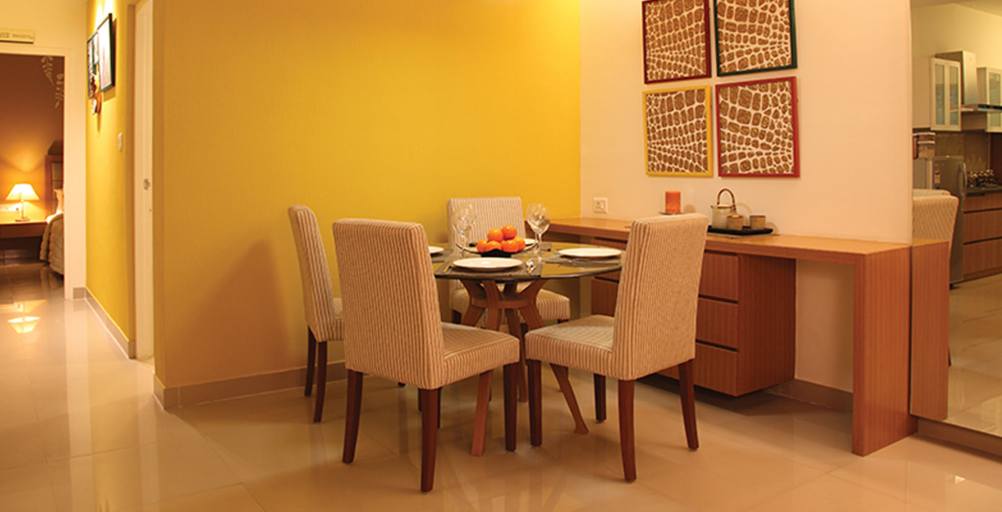 Dining at model apartment in Brigade Orchards