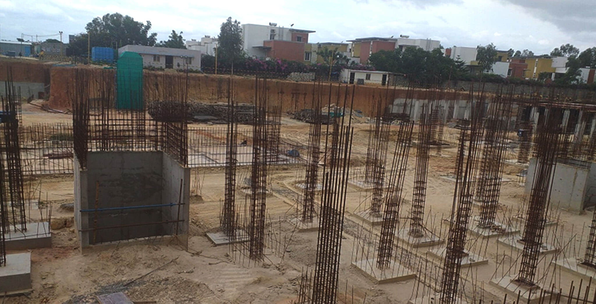 Aug 2019 - North side view: Q and R Block Footings completed, grade slab PCC and columns under progress.