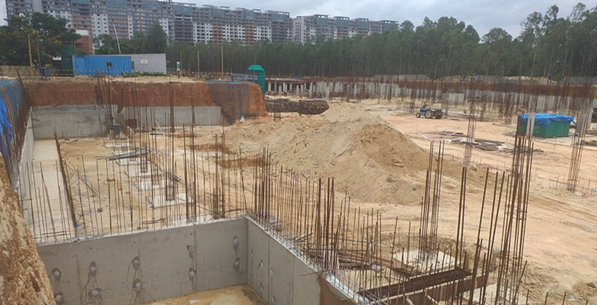 Aug 2019 - South side view: Rainwater Sump-04 wall concreting completed • D and C Block Retaining wall Concreting completed • D and E Block footings under progress