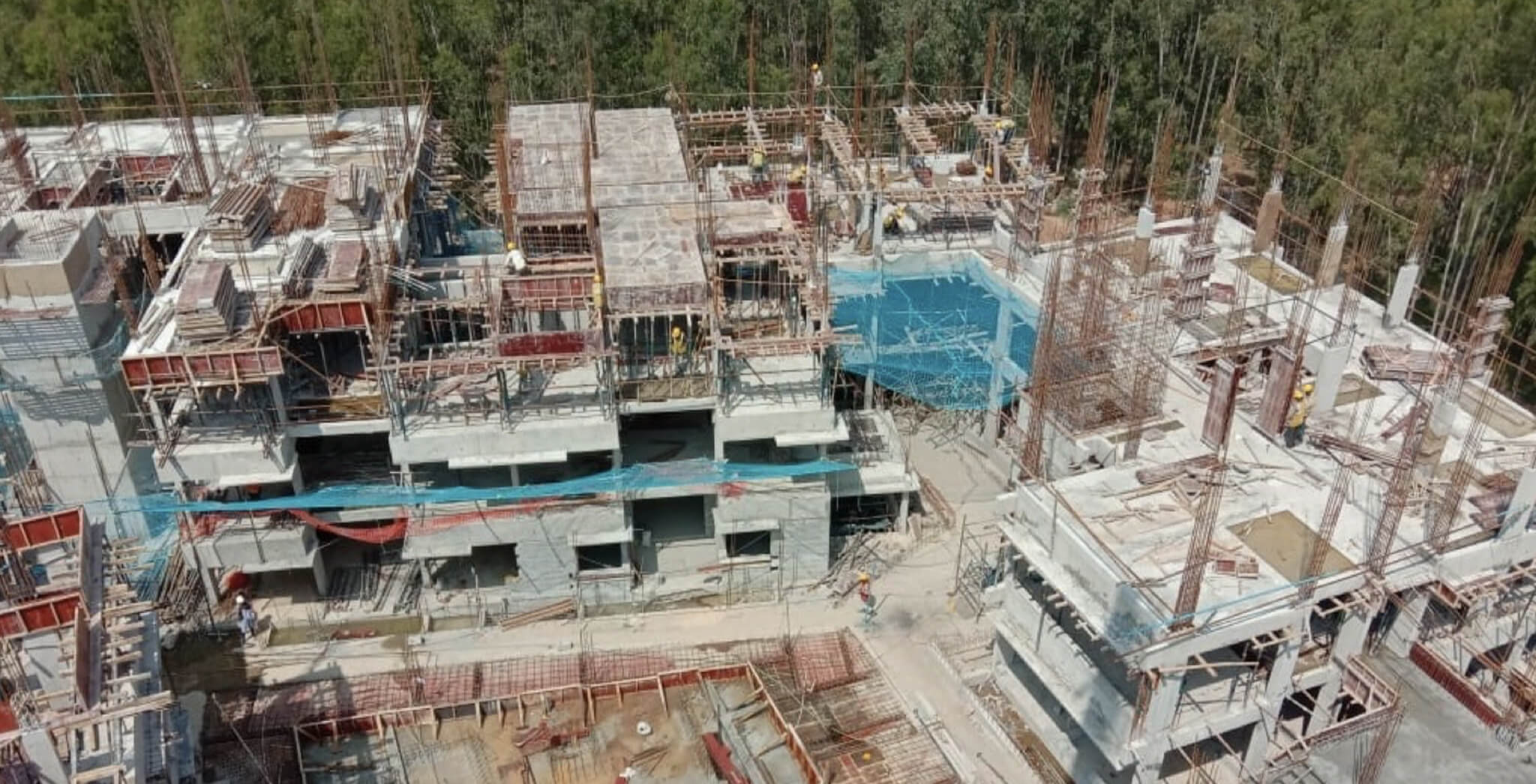 Nov 2019 - West side view: L Block—Third floor slab completed; M Block—Third floor shuttering work-in-progress; N Block—Second floor slab completed, columns work-in-progress