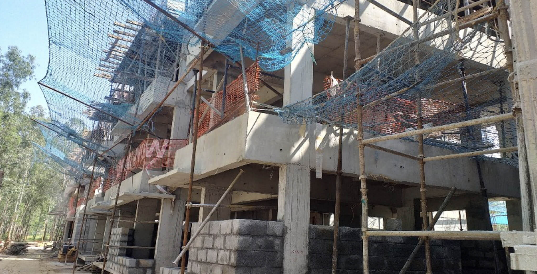Nov 2019 - West side view: L & M Blocks—Ground floor block work-in-progress