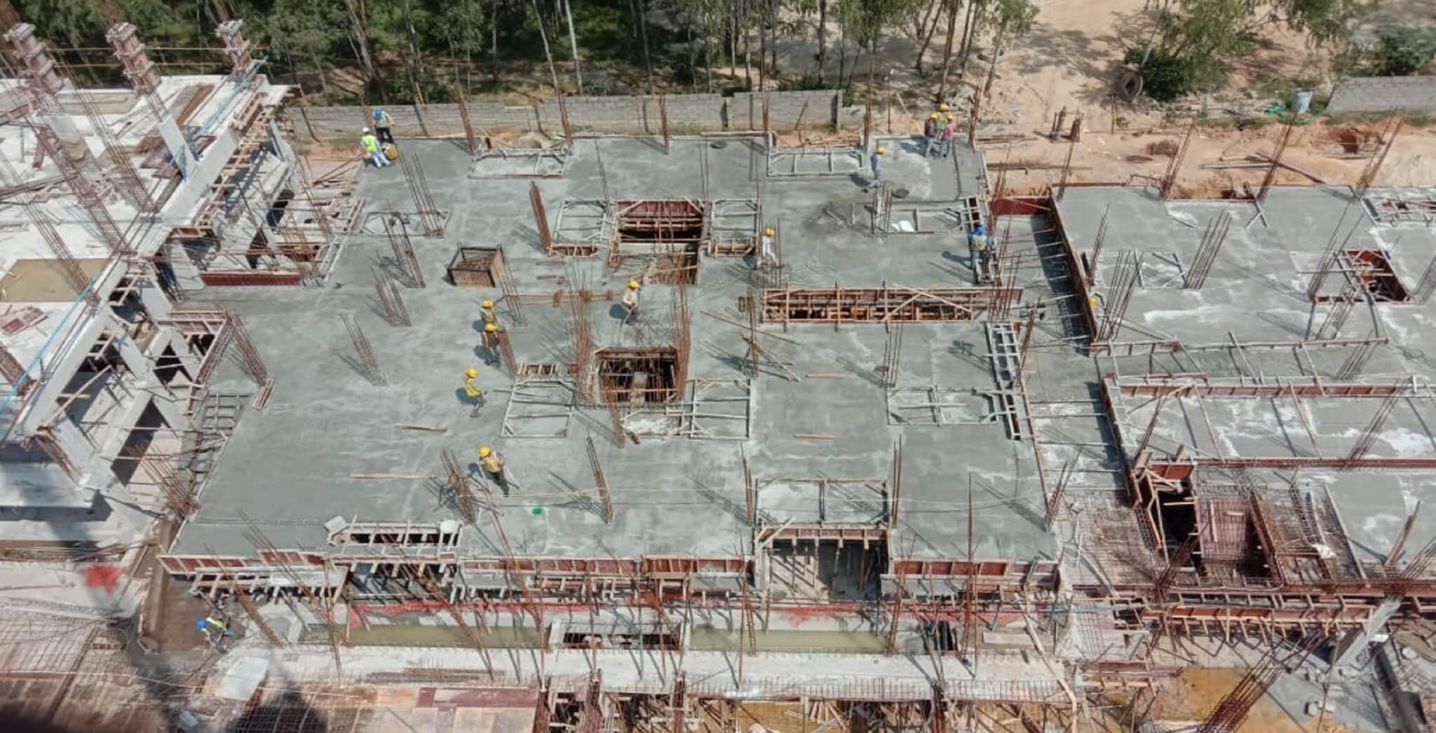 Nov 2019 - North side view: P Block—First floor slab completed, first floor to second floor column reinforcement work-in-progress