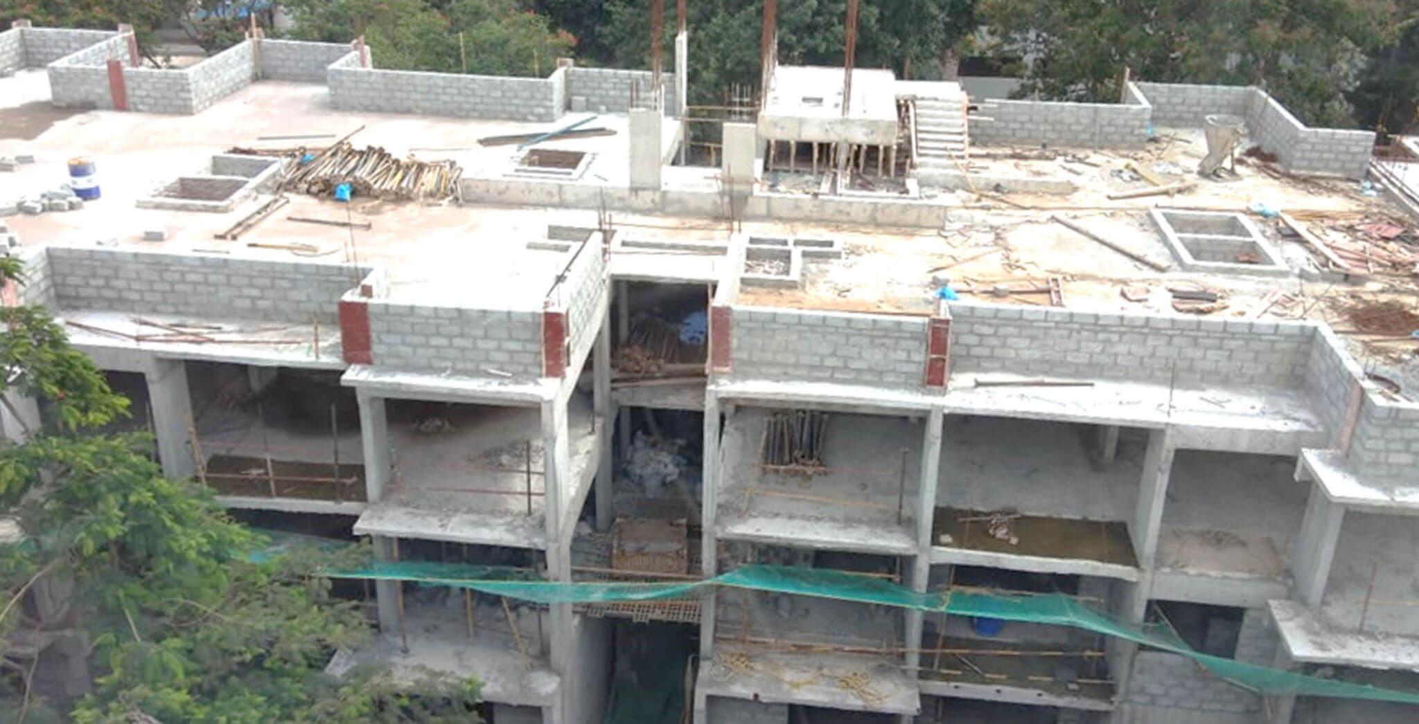Jun 2020 - F Block: Above terrace floor parapet wall block work-in-progress; Block work completed up to 2nd floor.