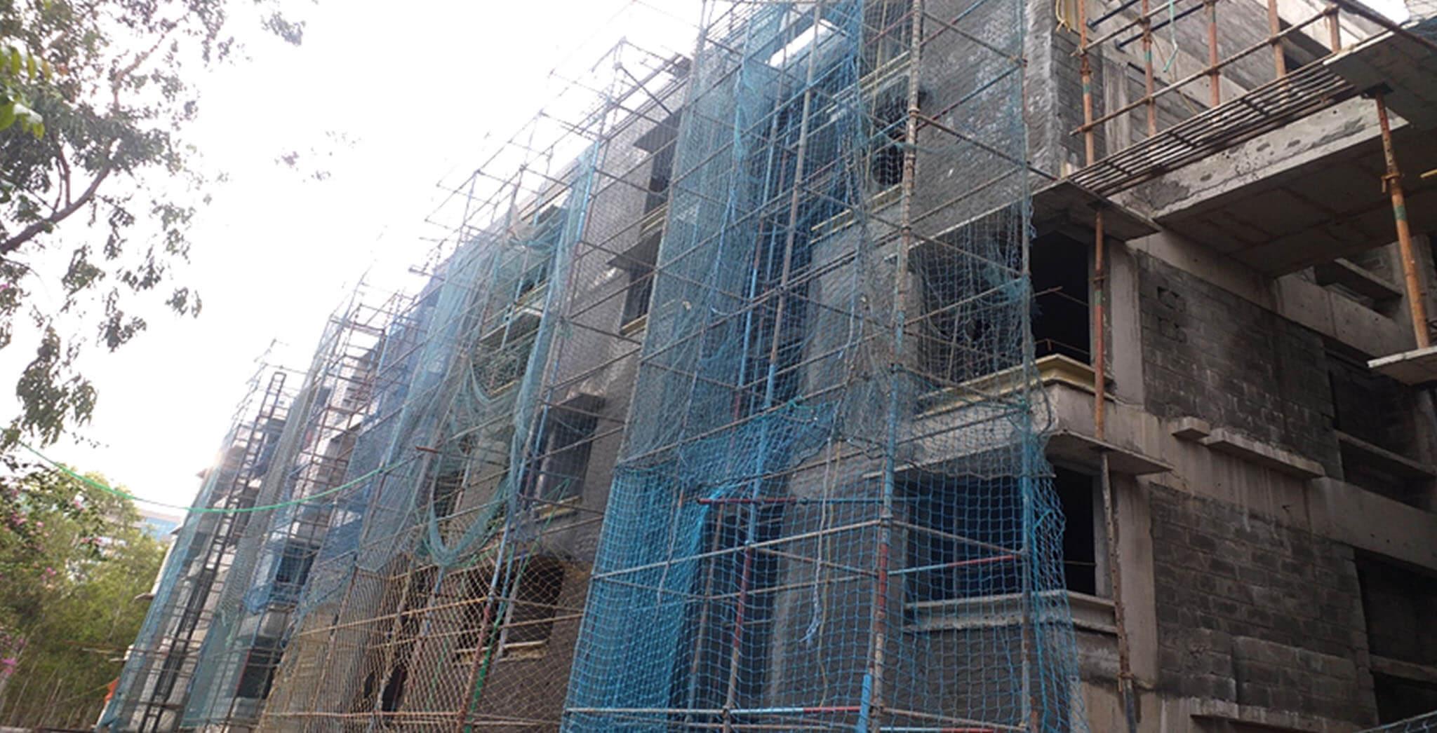 Jul 2020 - South side view: K Block–internal flat plastering completed, corridor plastering work-in-progress; External plastering work-in-progress.