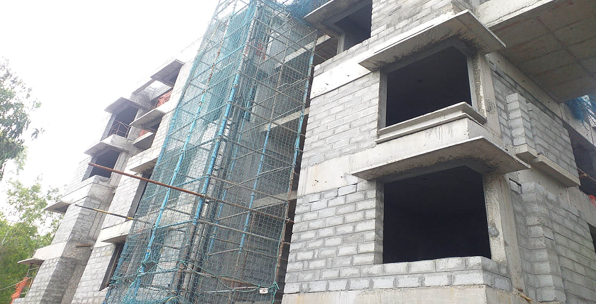 Jul 2020 - West side view: L Block–Blockwork completed, internal plastering work at 4th floor in progress.