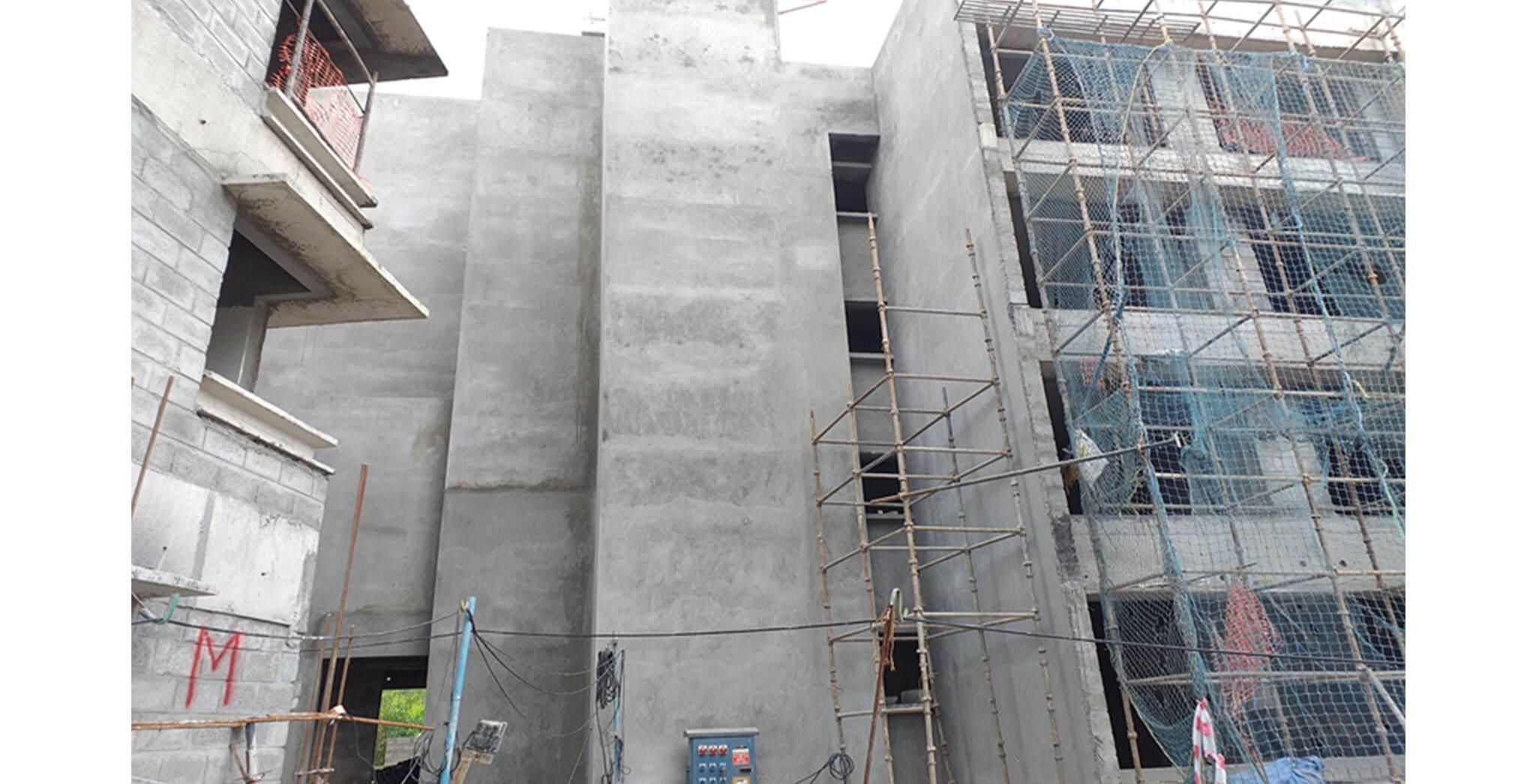 Jul 2020 - North side view: N Block—External wall plastering work-in-progress.