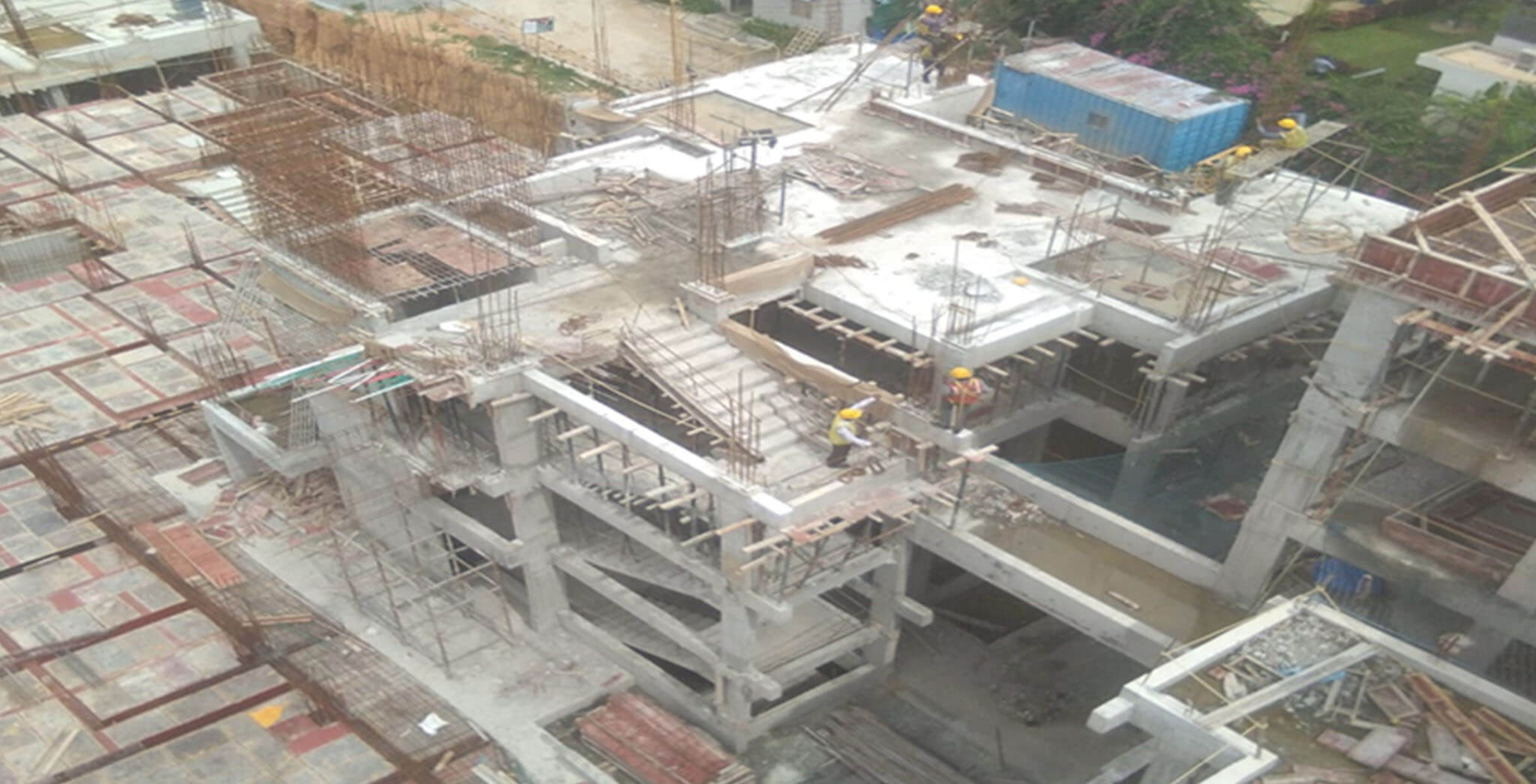 Jul 2020 - North side view: H Block—3rd floor pour-1 slab completed; 3rd floor to 4th floor column rebar work-in-progress.