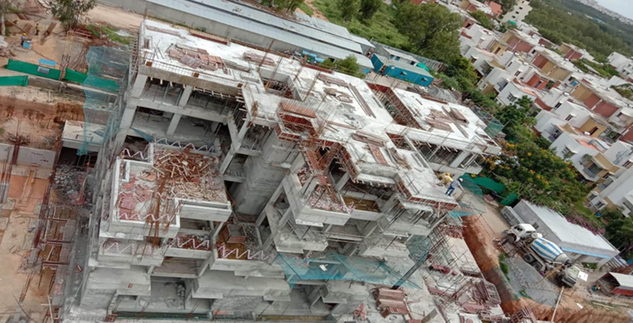 Jul 2020 - South side view: E Block—Terrace floor slab completed; Block work in first floor level in progress.