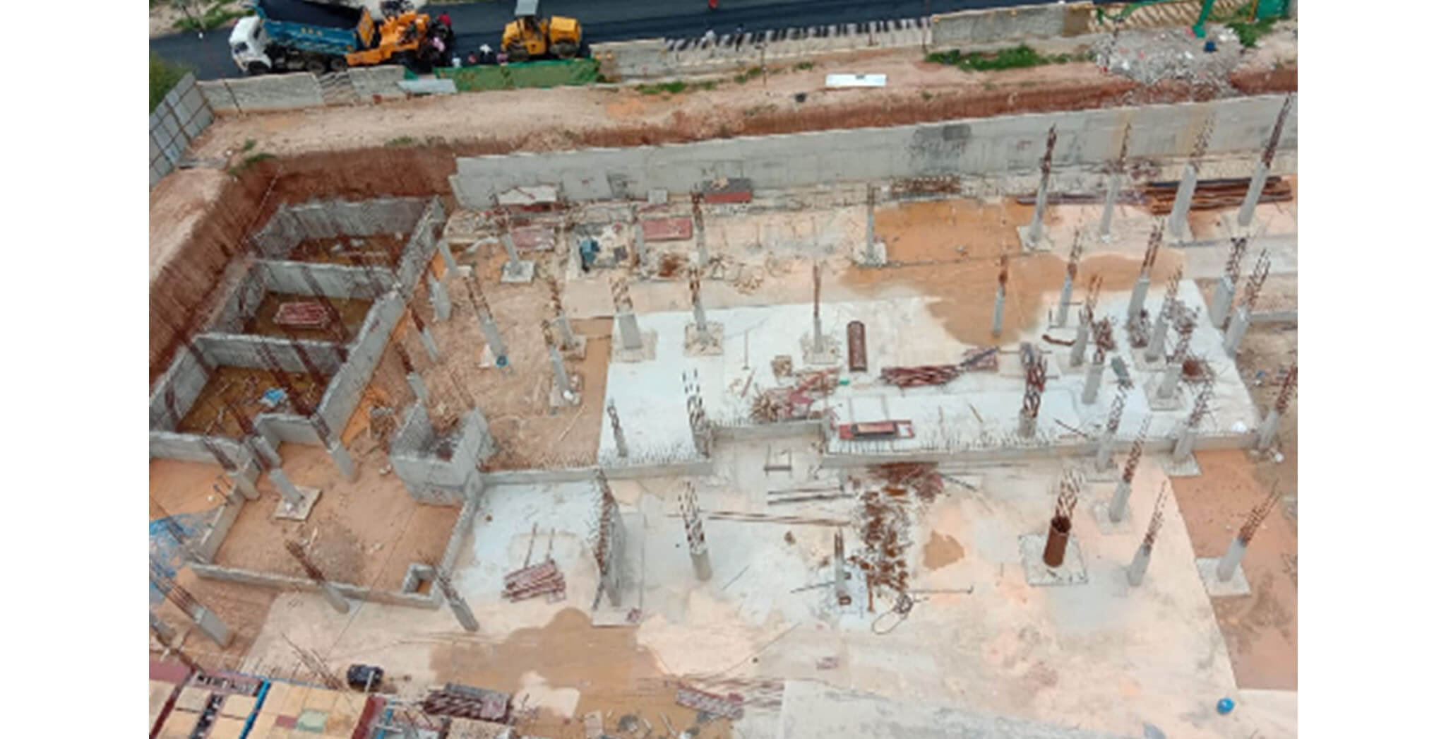 Jul 2020 - North side view: A Block–First floor shuttering in progress; Podium slab concreting completed.