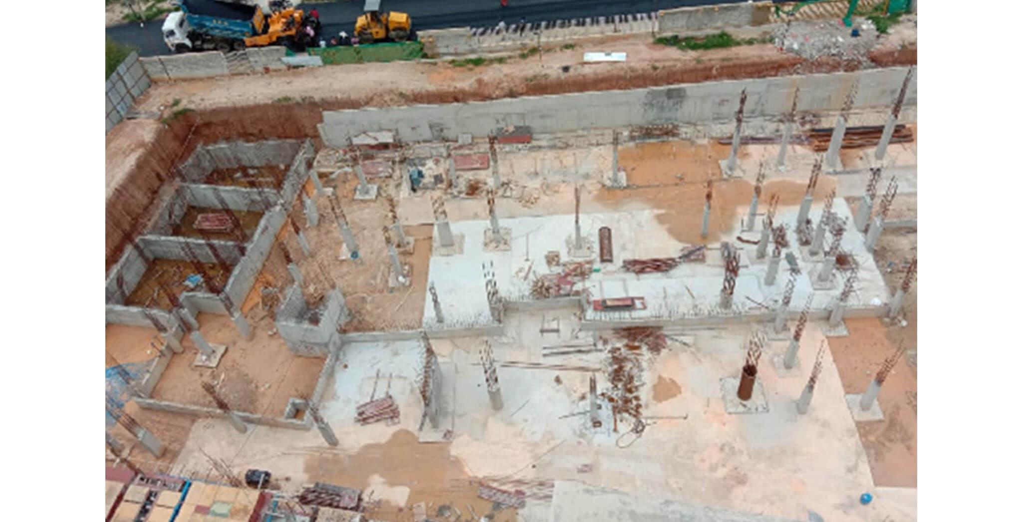 Jul 2020 - East side view: B & C Blocks—Grade slab PCC work-in-progress; UG Sump wall first lift completed, 2nd lift rebar tying work-in-progress.