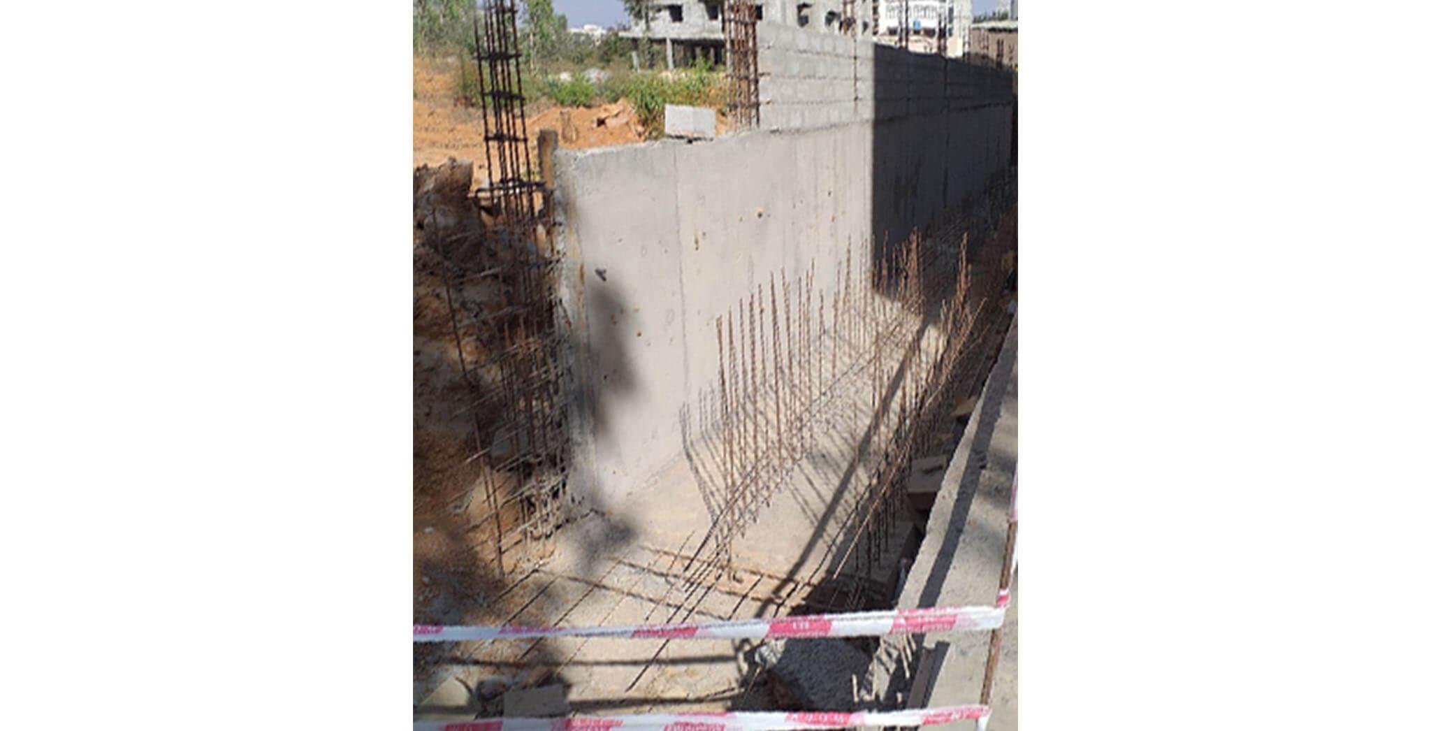 Jul 2020 - Northside compound wall: Northside compound wall raft reinforcement work-in-progress.