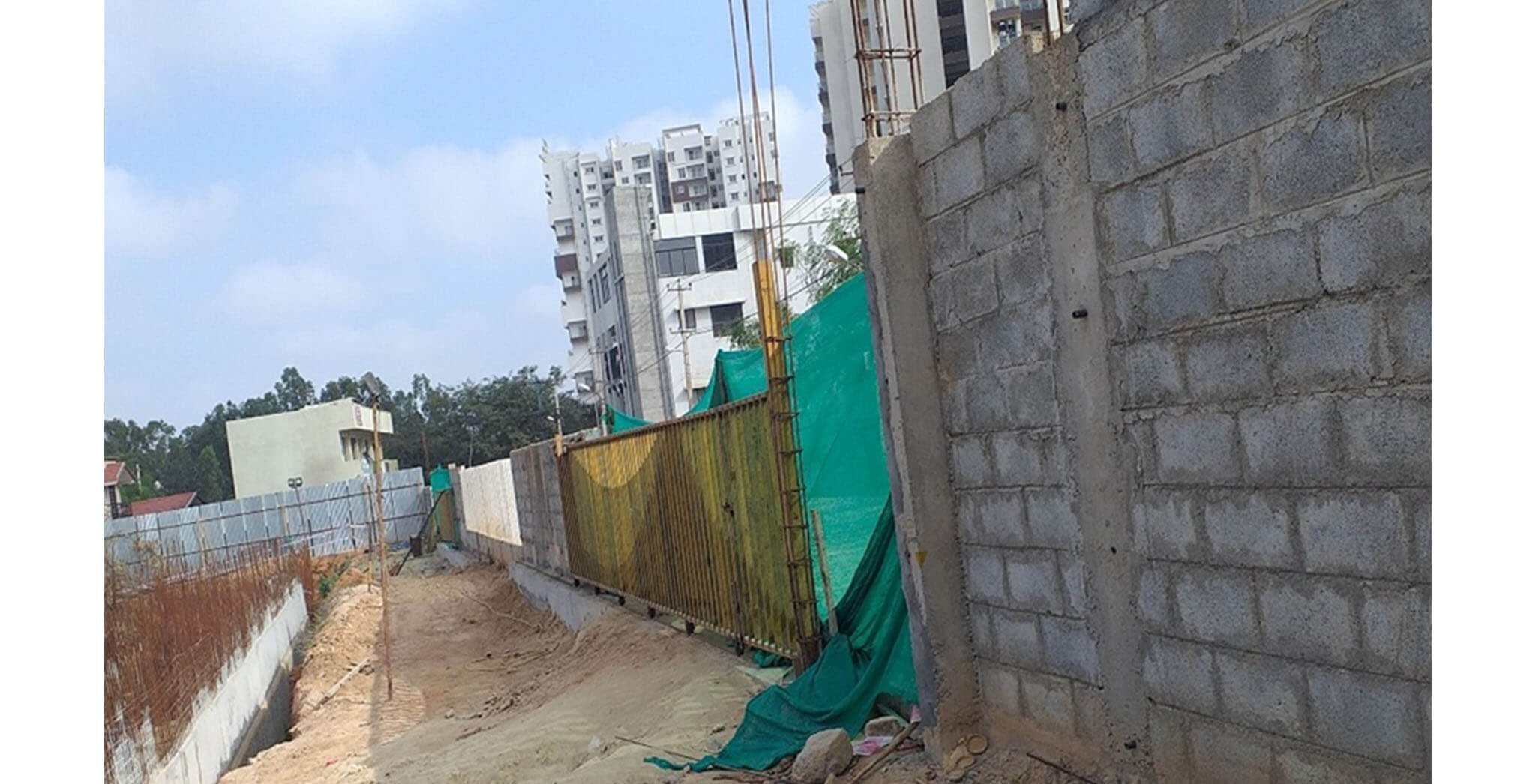 Jul 2020 - Front compound wall: Gate erection for Entry and exit completed.