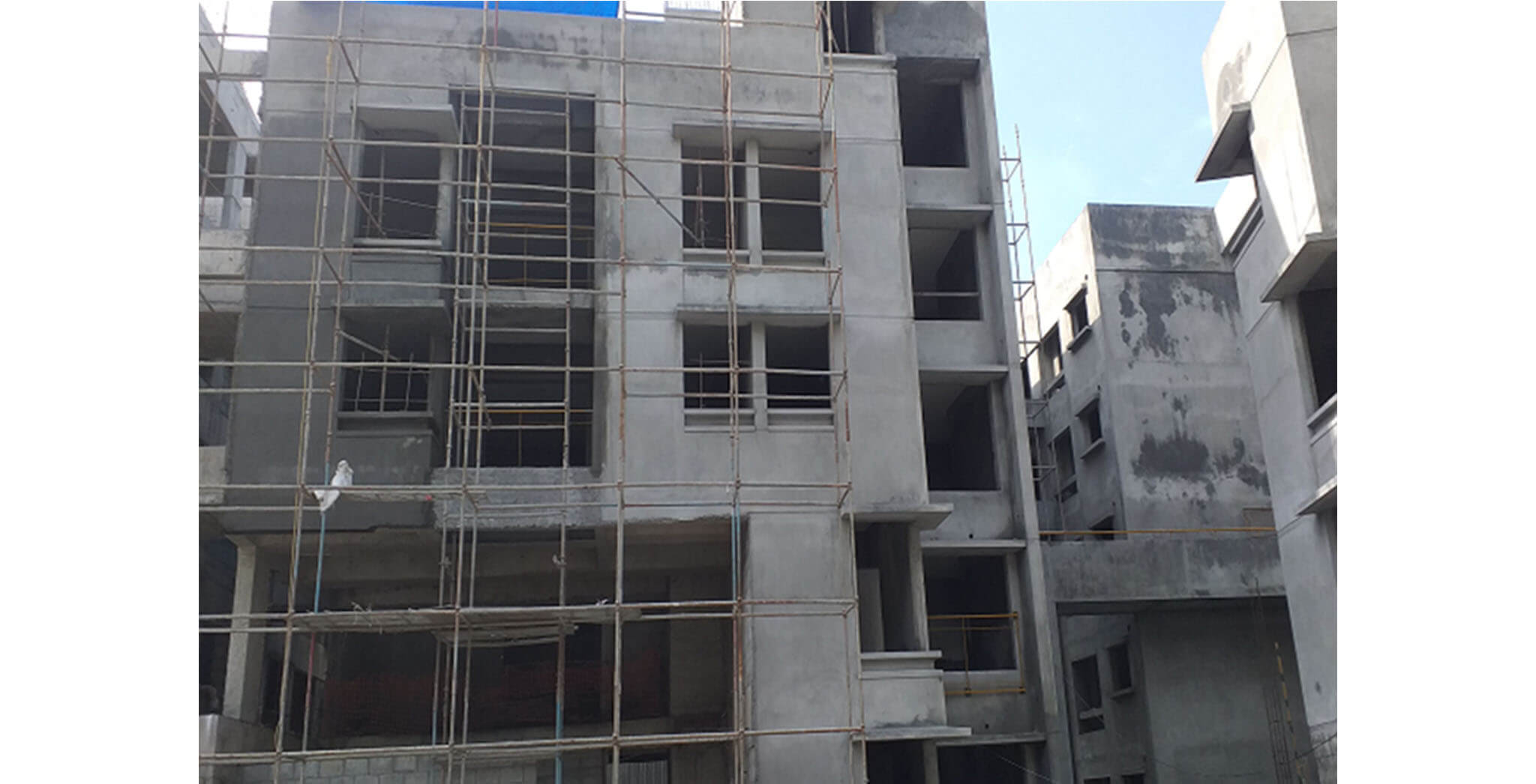 Oct 2020 - South side view: K Block—A view from podium area side; external plastering work completed