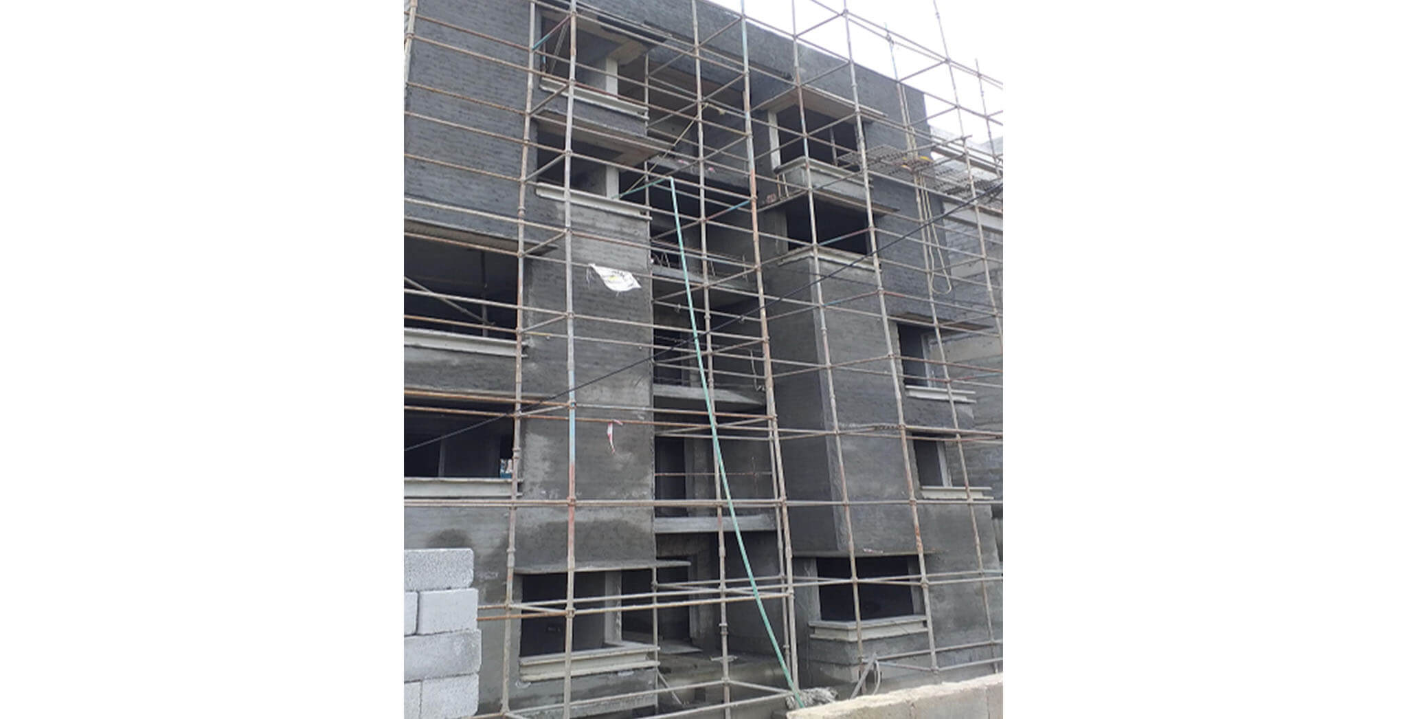 Oct 2020 - South side view: E Block—External plastering work-in-progress