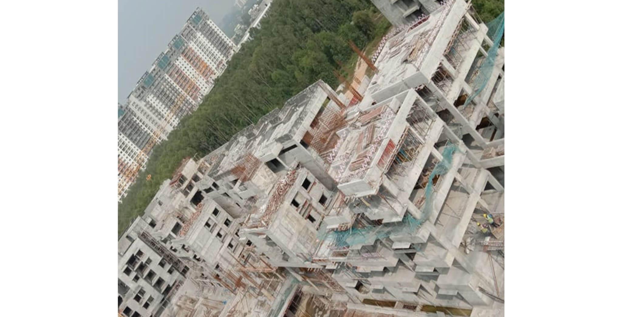 Oct 2020 - North side view: R Block—Terrace floor completed; R Block—1st floor blockwork-in-progress