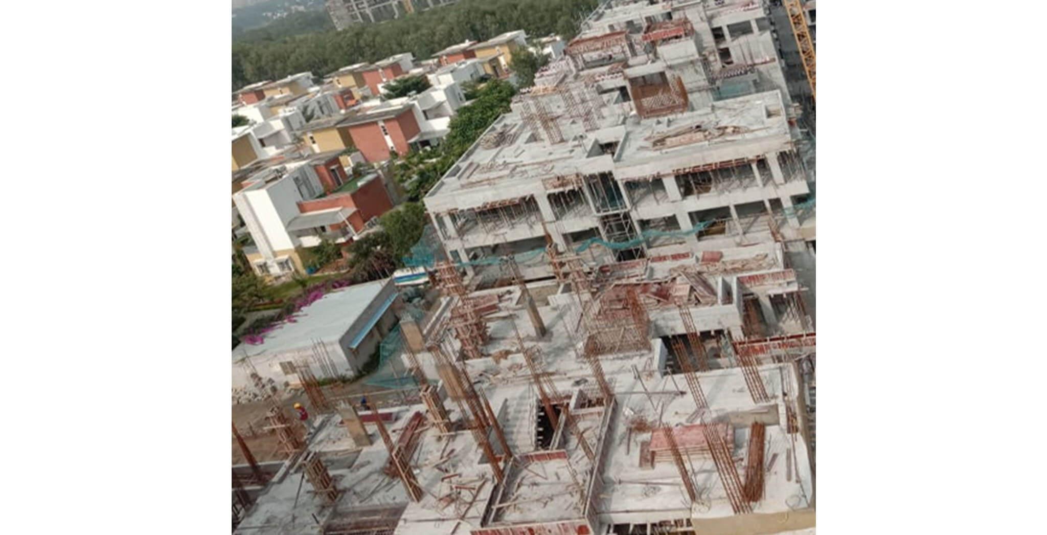 Oct 2020 - West side view: G Block—Terrace floor completed, 2nd floor blockwork-in-progress; F Block—3rd to 4th floor column work-in-progress