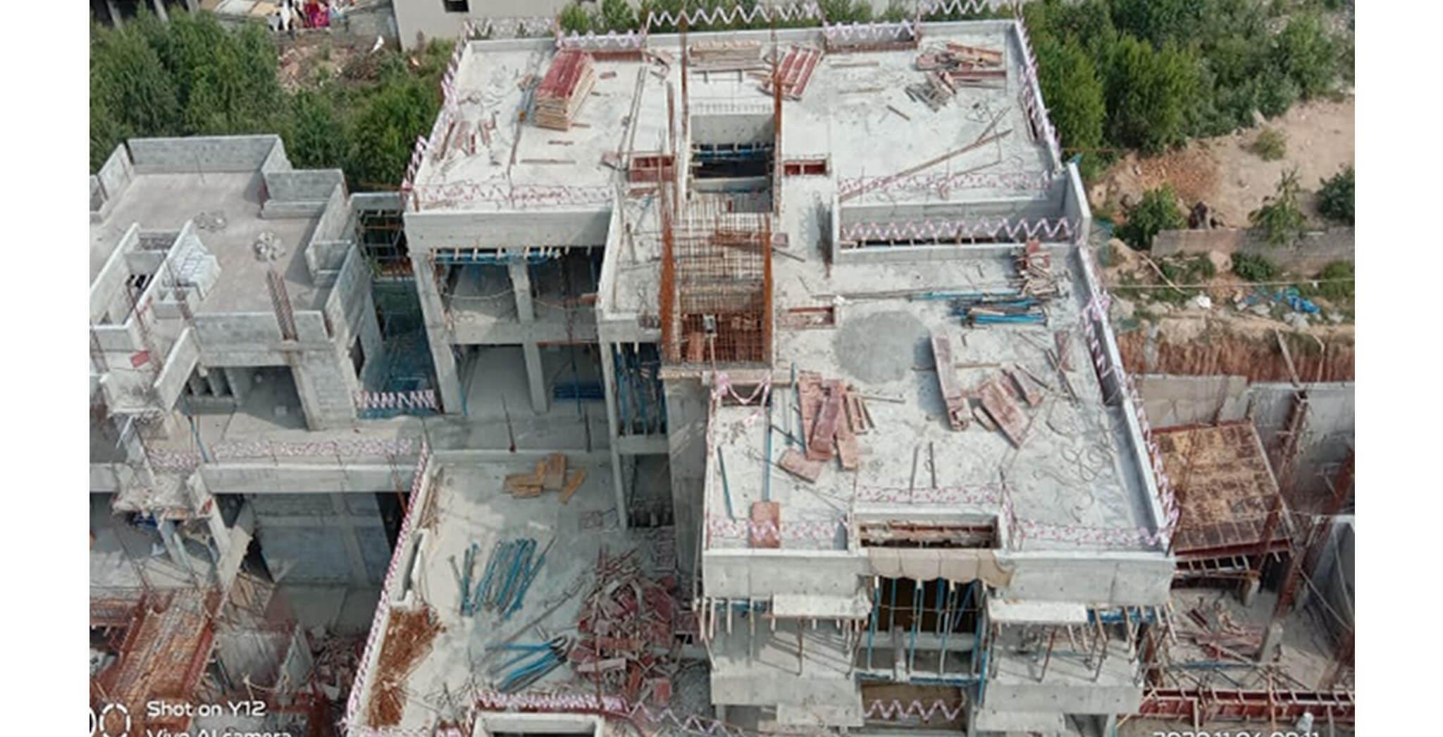 Oct 2020 - North side view: A Block—terrace slab completed; 1st floor blockwork-in-progress