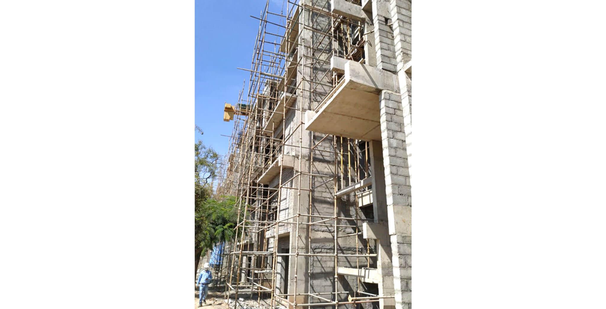 Dec 2020 - J Block: South elevation external plastering work-in-progress.