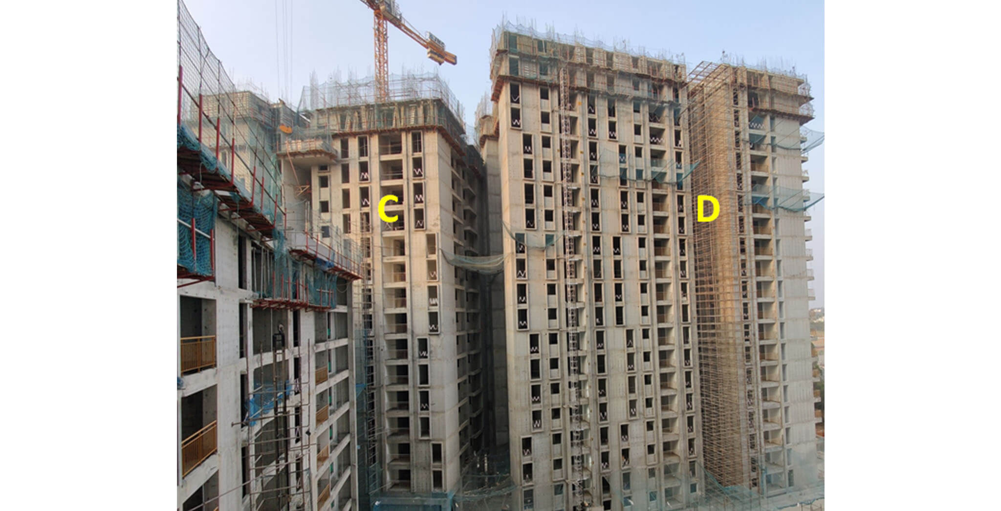 Feb 2021 - Serene: Tower C—17th floor slab completed; Tower D—20th floor slab structure work-in-progress