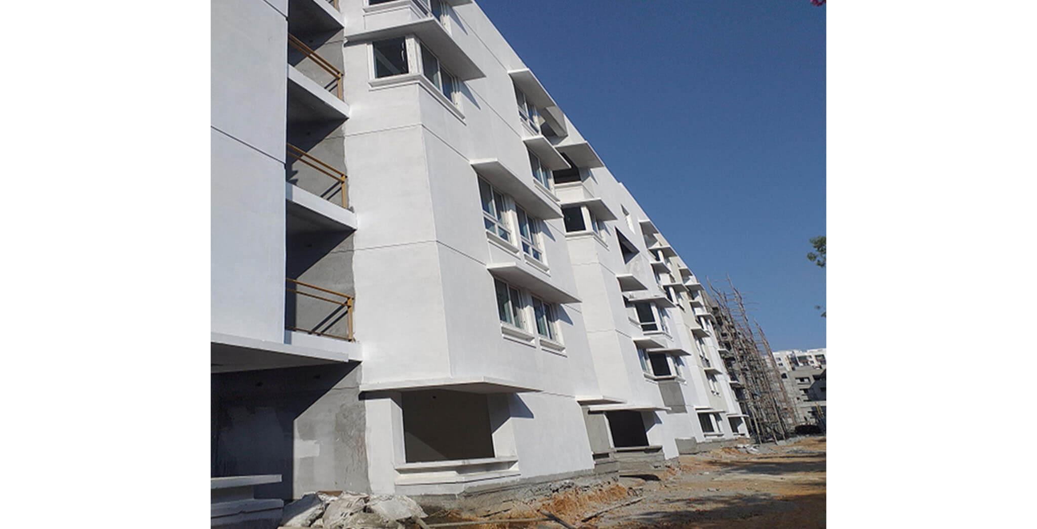 Feb 2021 - South side view: K & L Blocks—South side external wall Primer work-in-progress