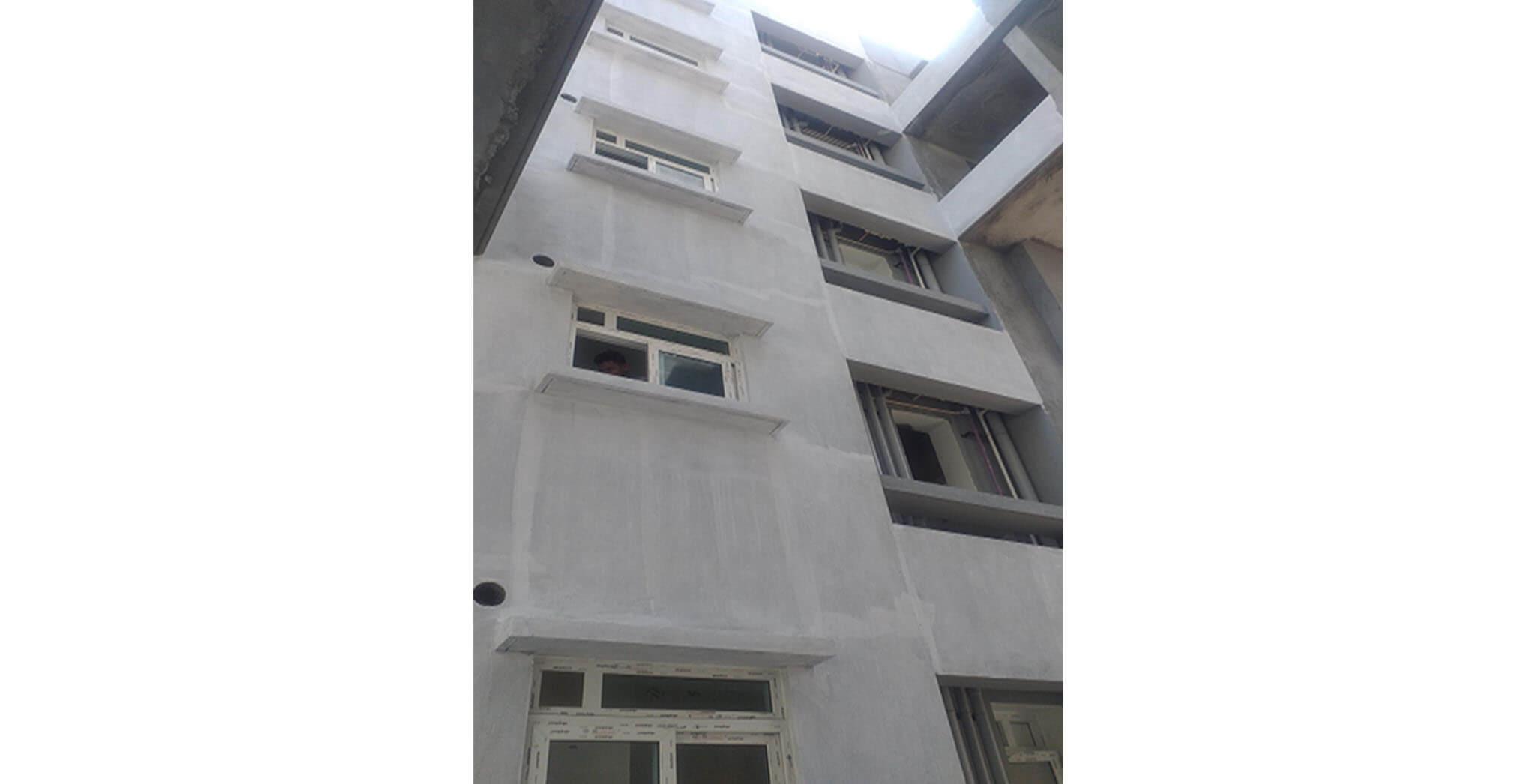 Feb 2021 - Podium side view: K Block—External wall primer work-in-progress