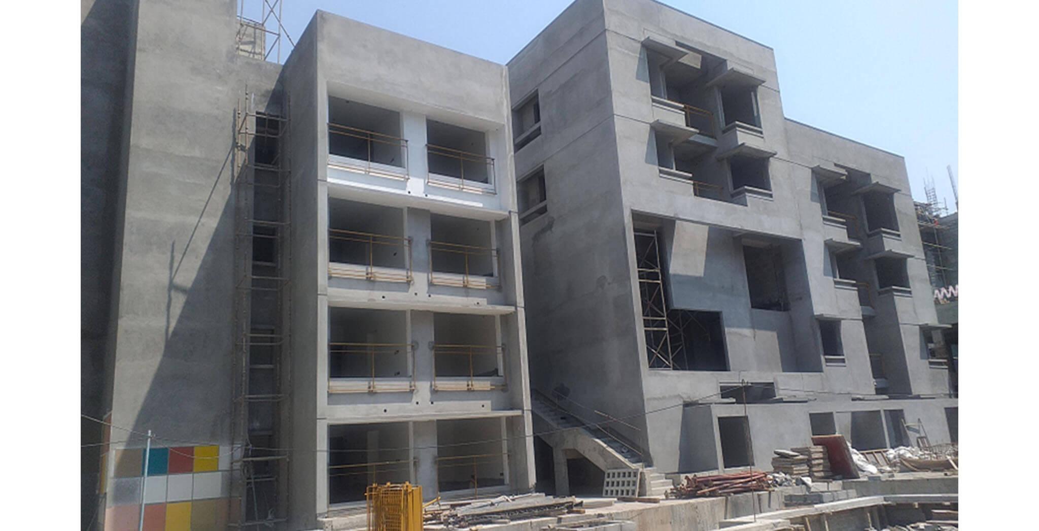 Feb 2021 - Podium side view: N Block—External wall primer work-in-progress