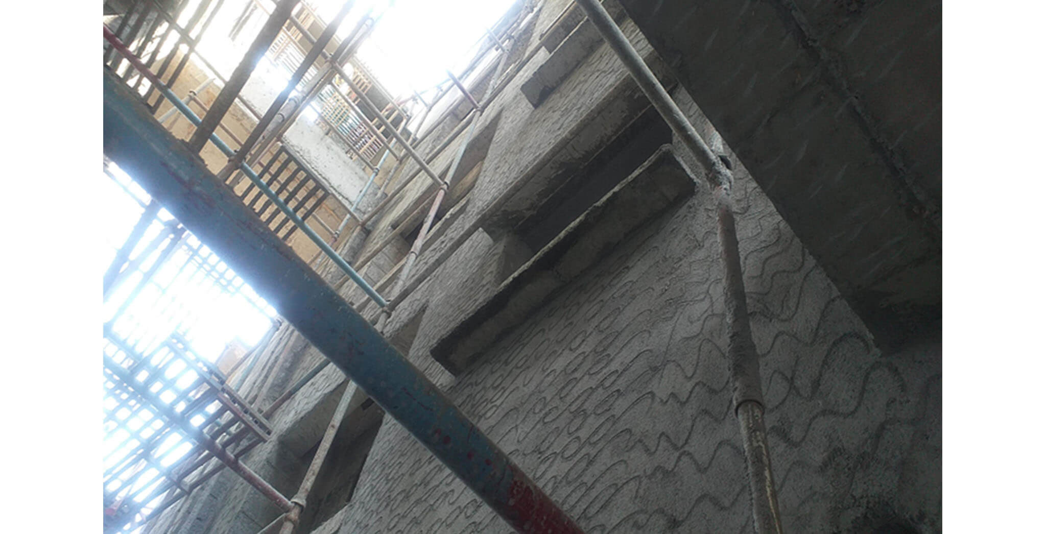Feb 2021 - West side view: P Block—West side wall external plastering work-in-progress