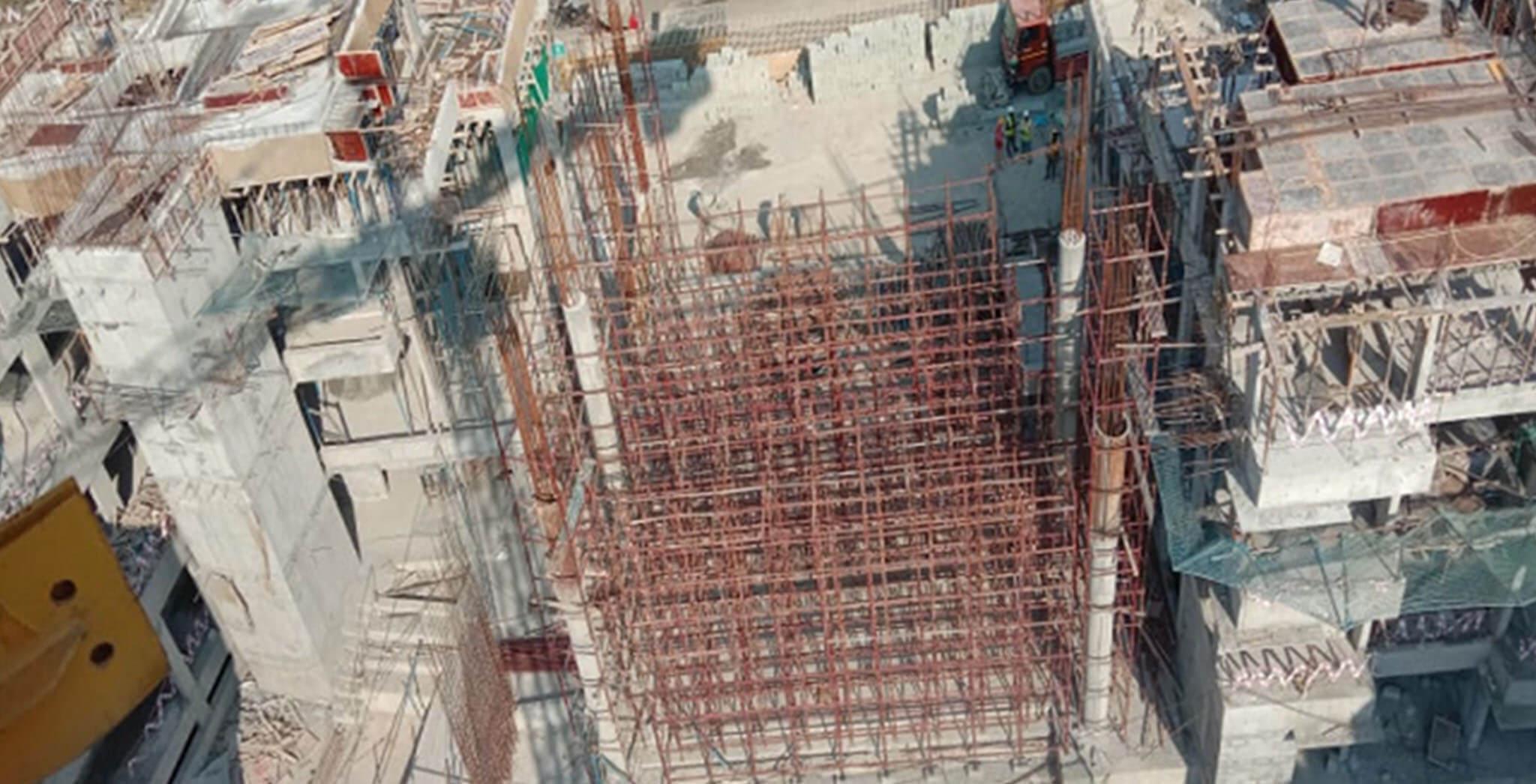 Feb 2021 - East side view: B Block—Terrace floor slab completed; C Block—Gym area shuttering work-in-progress