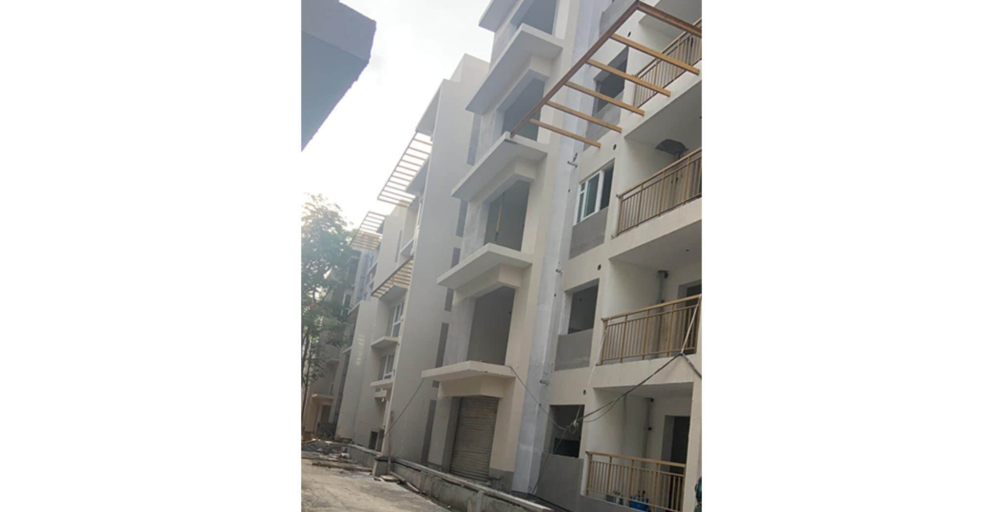 May 2021 - G Block: South elevation balcony railing painting works commenced; UPVC window installation work-in-progress.