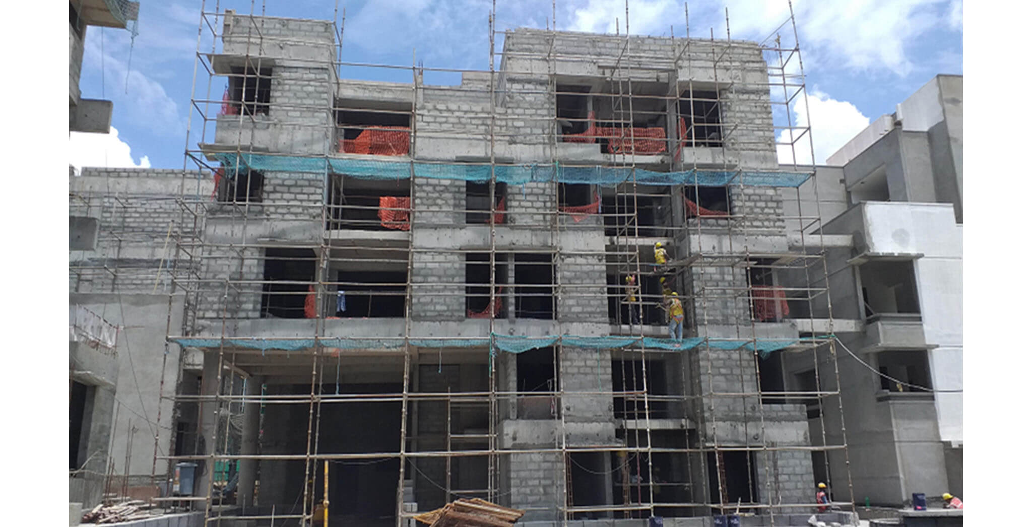 Jun 2021 - Podium side view: Block D—Podium side external plastering work-in-progress