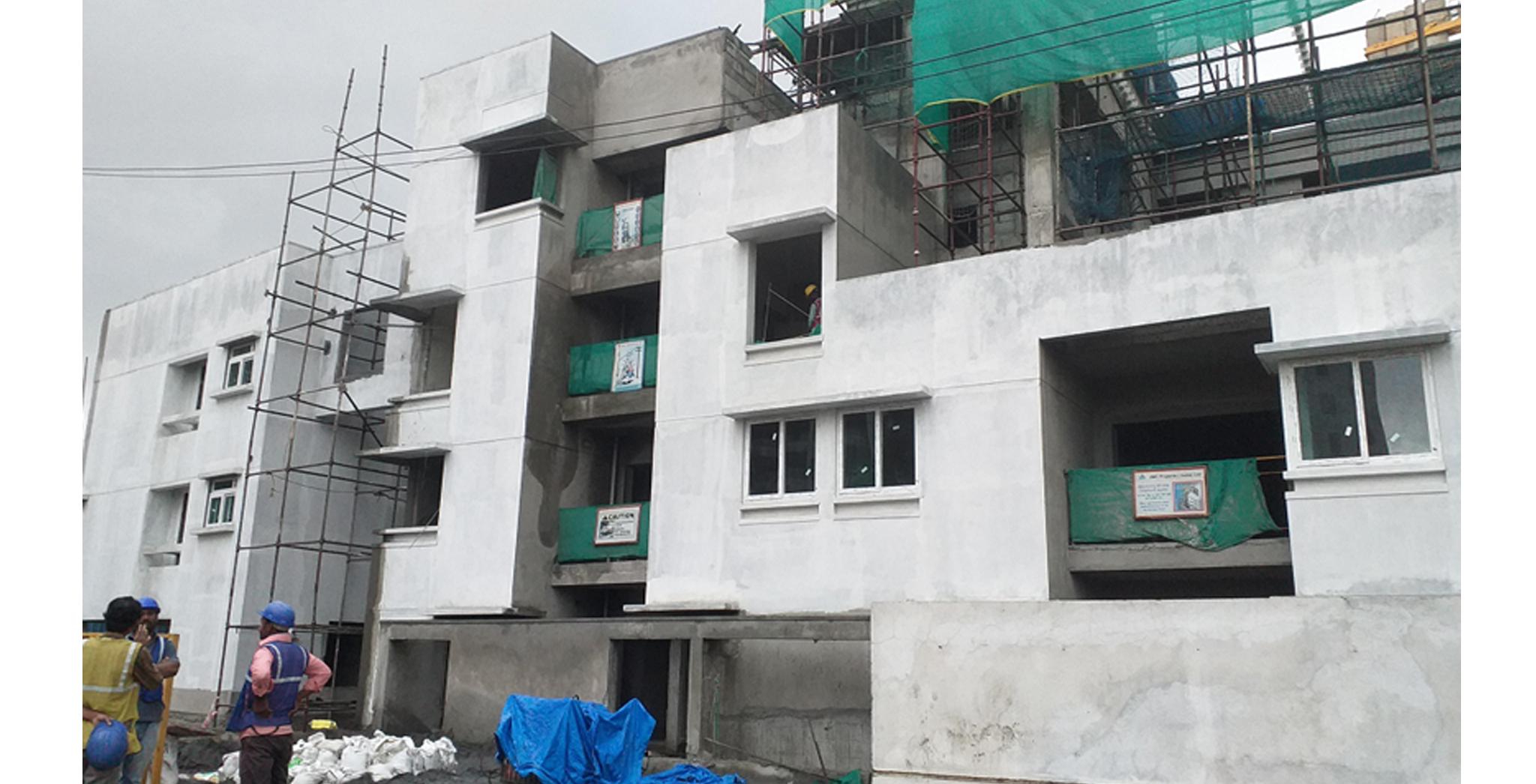 Aug 2021 - Block C: East side view - External plastering works completed, external primer works in progress at east side