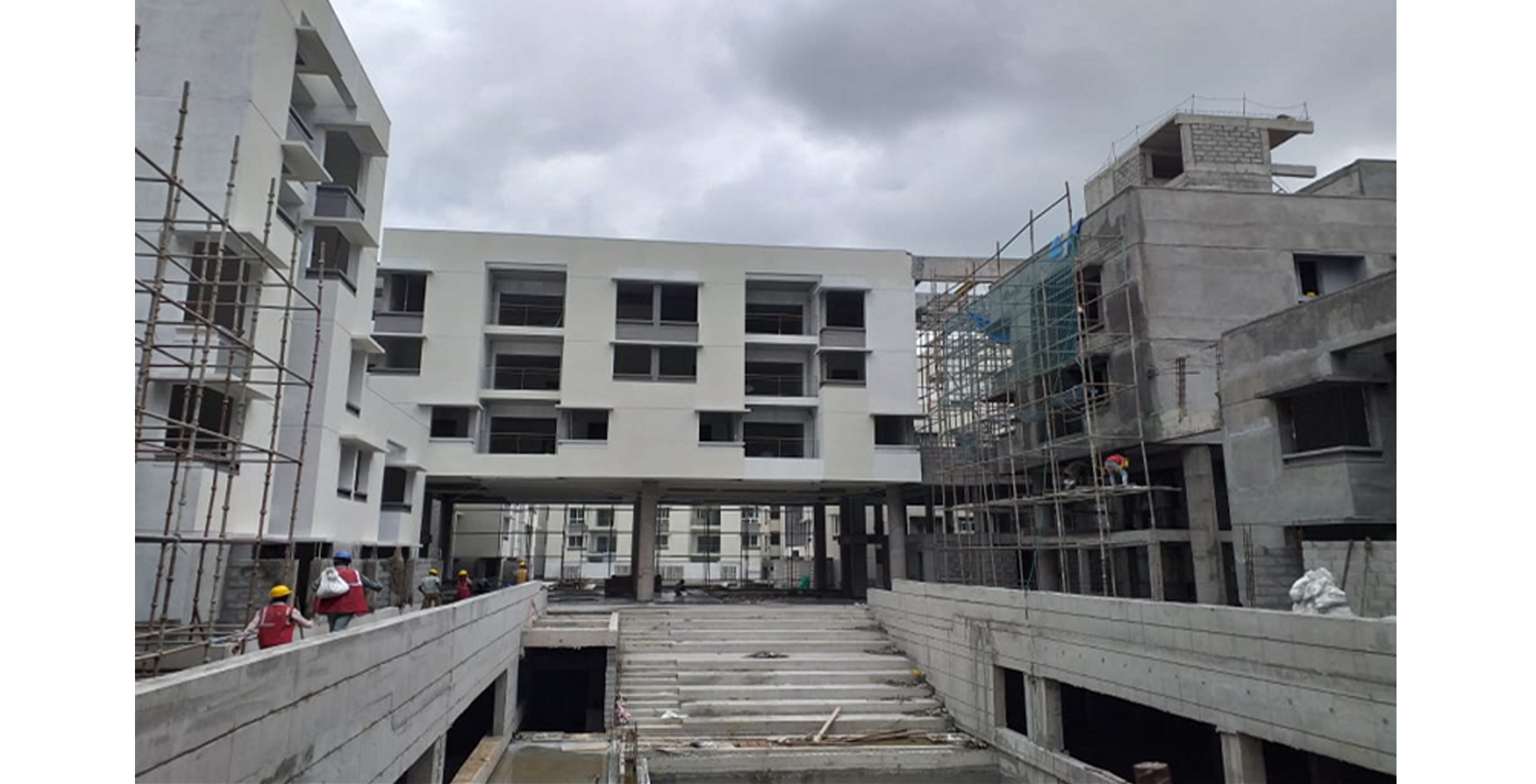 Aug 2021 - Podium Side: Block H - External plastering works completed, painting works in progress
