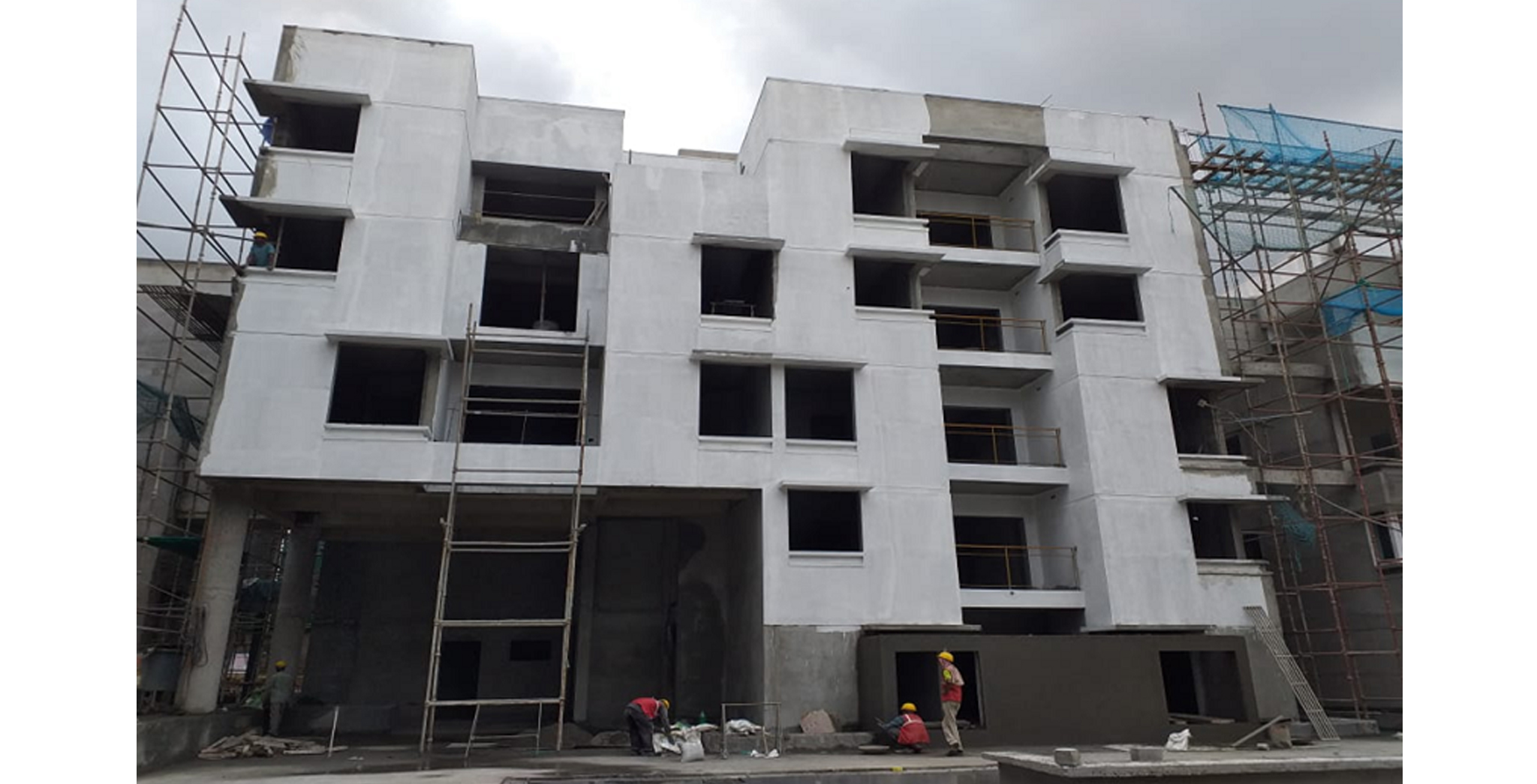 Aug 2021 - Podium Side View: Block D - External plastering completed, painting works in progress